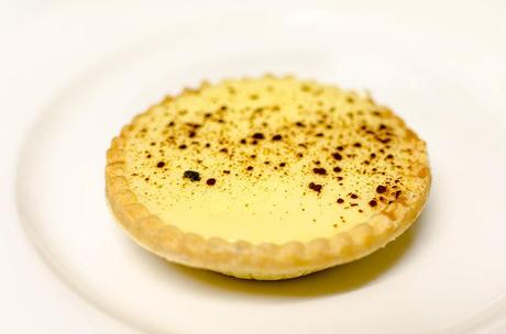 custard tart on white plate