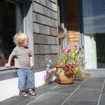 a young visitor admires the entrance to the Chalk Wall House