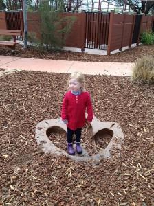 Julia in dinosaur footprint
