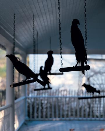 Love these simple but dramatic raven decorations the perches are just