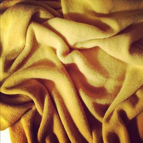 "New ""sunshine"" West Elm throw. Perfect for reading in bed in the winter."