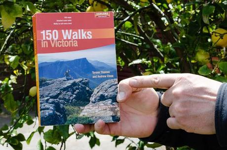 holding book 150 walks in victoria by tyrone thomas and andrew close