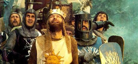 MONTY PYTHON AND THE HOLY GRAIL:   Eric Idle, Michael Palin, center from left: John Cleese, Terry Jones (helmet), Graham Chapman as King Arthur (front), 1975