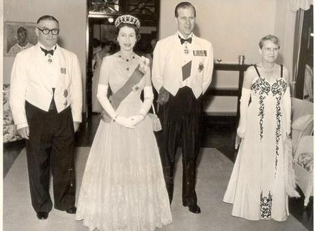 "It's Queen Elizabeth and Prince Philip's 65th wedding anniversary today. To celebrate, I'm posting this picture of them next to a hilarious man wearing a dress. Prince Philip: ""For heaven's sake, Roger, take off that white dress and stop acting like a homosexual!"" (I think I just crossed the line with that one. The person in the white dress is clearly a very nice lady. In the spirit of Prince Philip reputedly being a bigot, however, I will keep it.)"