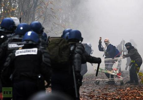 Protestors against a project to build an international airport clash with riot police following the evacuation of their squat nearby, on November 23, 2012 in Notre-Dame-des-Landes, western France (