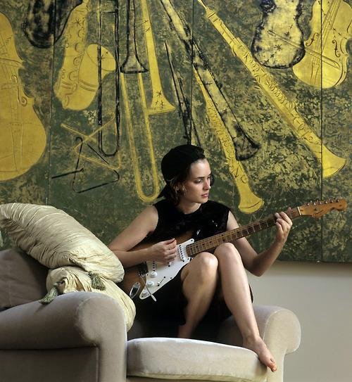 Winona Ryder, playing guitar in her apartment, 1994