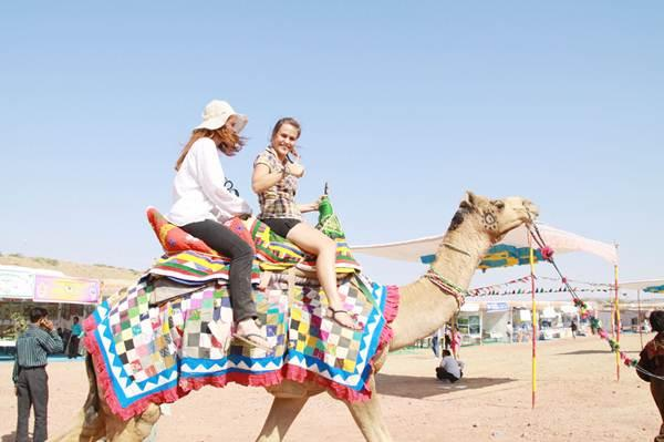 Tourists taking Camel Ride