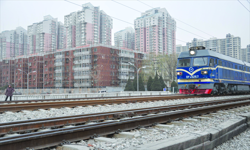 A train passes by residential buildings along the Beijing-Baotou railway in Beijing. The new high-speed railway to Shenyang is planned to go parallel with this route. Photo: Liu Sha/GT