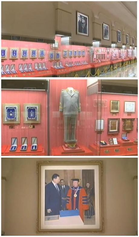 Degrees and titles can be seen in the top image.  In the middle image KJI's military dress uniform and other awards can be seen.  In the bottom image, KJI participates in a hooding ceremony to receive an honorary academic degree (Photos: KCTV/KCNA screengrabs)