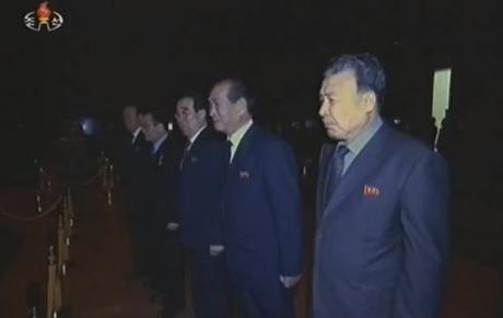 Chief Secretary of the Pyongyang City (municipal) KWP Committee Mun Kyong Dok and senior party officials pay their respects.  Also visible in this image are Kwak Pom Gi, Kim Pyong Hae, Kim Yong Il and Kim Yang Gon (Photo: KCTV/KCNA screengrab)