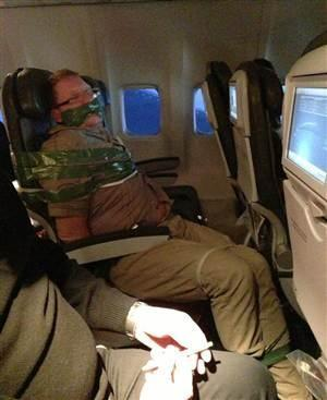 Passenger became unruly and tape to seat