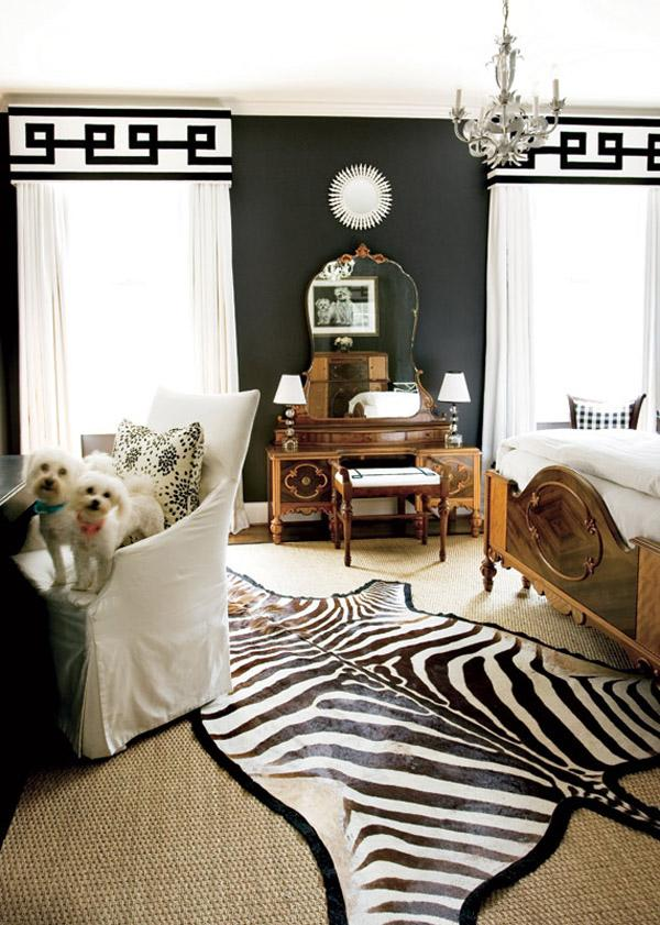 a contemporary bedroom using black  on the walls and white graphic draperies