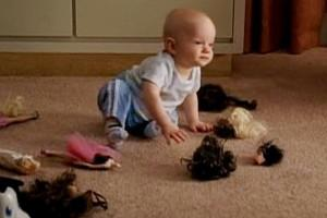 Baby Mikey w/decapitated Barbies