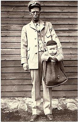 Letter Carrier With Child In Mailbag