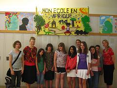 6th graders in front of their banner displayed...