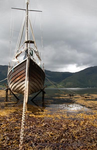 Photo - an old wooden sailing boat in the bay at Ballachulish, Scotland