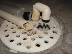 Water softener discharge at floor drain