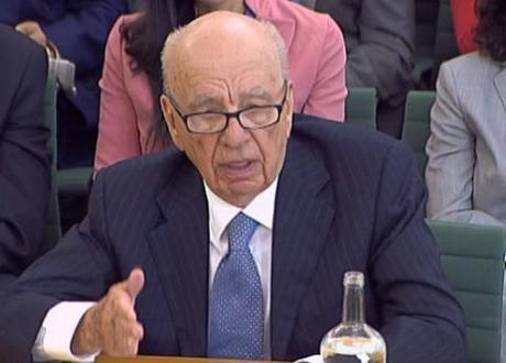 Rupert Murdoch eats humble pie, sustains foam pie attack at select committee hearing