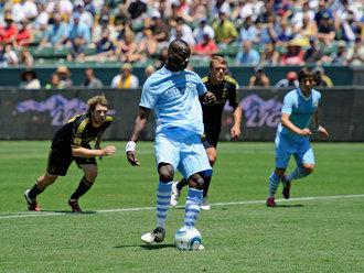 http://images.sportinglife.com/11/07/330/mario-balotelli-manchester-city-2011_2626215.jpg