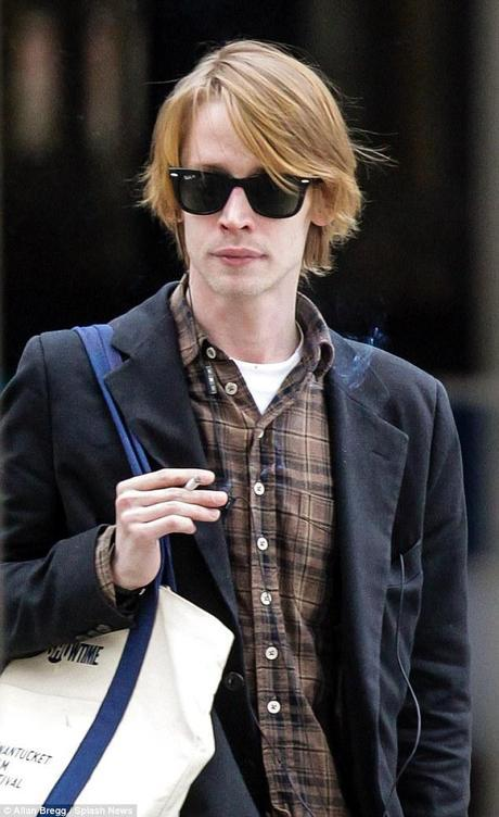 Casual in the city: Macaulay, who has an apartment in New York's SoHo neighbourhood, looked hip in gray jeans, brown plaid shirt and a charcoal dress jacket