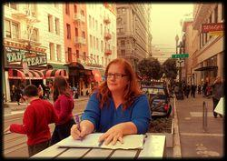 Here I am writing plein air poetry on Powell Street in San Francisco: the town where Imogen lived.
