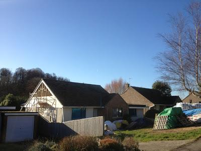 blue sky, sunshine and half a cedar-clad gable