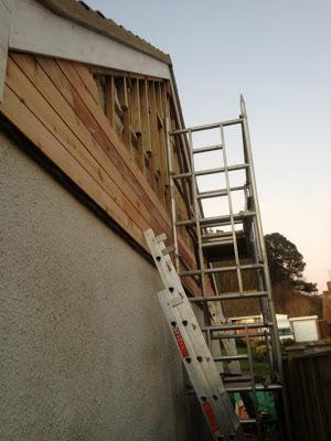 Cedar cladding being fitted to gable wall