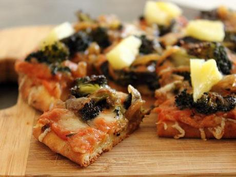 Flatbread Pizza with Roasted Red Pepper Sauce, Broccoli, Caramelized Onions, and Pineapple