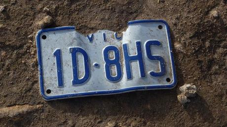 victorian number plate lying on track