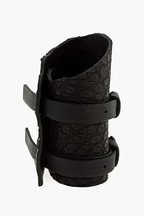 Balmain Black croco-embossed Buckle cuff ($900) available at...