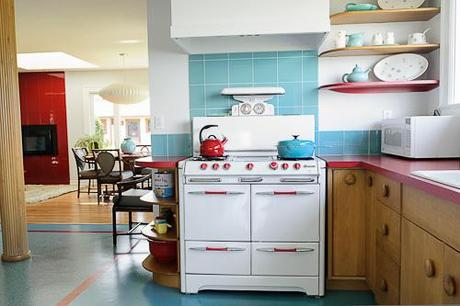 From Retro Renovation, a really cool example of formica used well with natural wood cabinets and white appliances.
