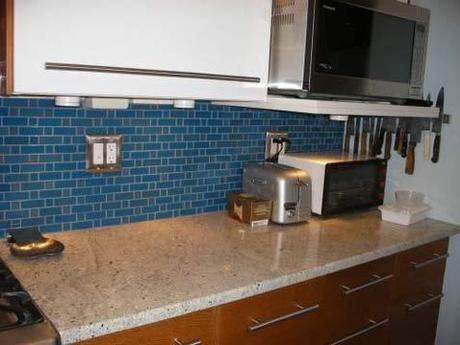 Knotty pine cabinets + neutral counters + blue backsplash