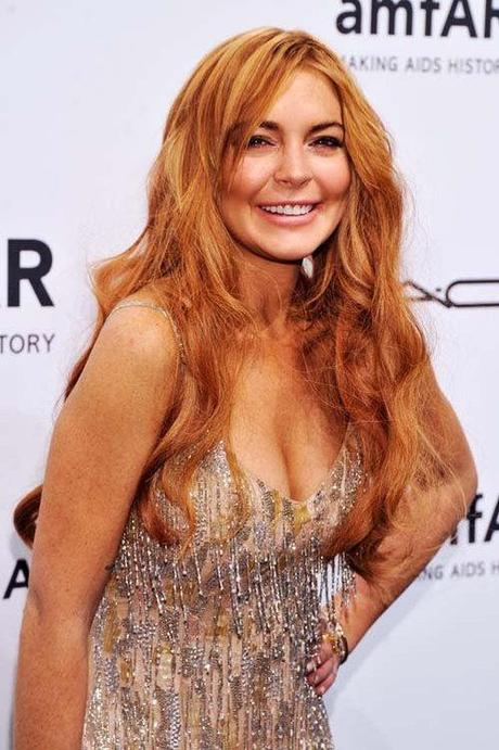 Celeb Style: Lindsay Lohan attended the amfAR New York Gala to...