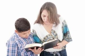 son and mother reading
