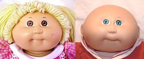 two Cabbage Patch Kids dolls, a girl and a boy with their distinctive bright eyes, fat chubby faces, tiny puckered mouths, and goofy expressions