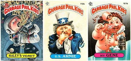 three Garbage Pail Kids trading cards from mid-1980s, Haley's Vomit as astronaut puking in space capsule, U.S. Arnie in Uncle Sam outfit picking his nose, Hy Gene shaving skin off his face and bleeding
