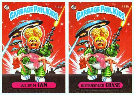 two Garbage Pail Kids trading cards, both with identical art showing alien invader carrying earth woman with flying saucers, example of cards with duplicate art only difference being kid names and card ID numbers