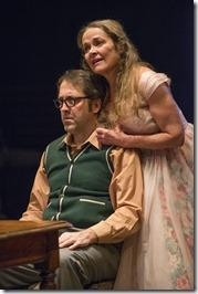 ) Meg (ensemble member Moira Harris) sings a tune for Stanley (ensemble member Ian Barford) on his birthday in Steppenwolf Theatre Company's production of The Birthday Party by Harold Pinter, directed by ensemble member Austin Pendleton.