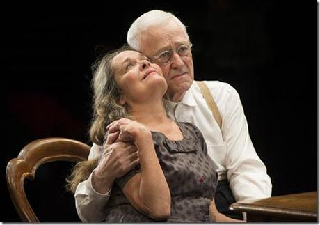 ) Petey (ensemble member John Mahoney) embraces his wife, Meg (ensemble member Moira Harris) in Steppenwolf Theatre Company's production of The Birthday Party by Harold Pinter, directed by ensemble member Austin Pendleton.