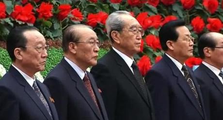 Yang Hyong Sop (2nd L) and Kim Ki Nam (3rd L) and other senior officials attend the opening ceremony of the 17th Kimjongilia Festival in Pyongyang on 14 February 2013 (Photo: KCTV screengrab)