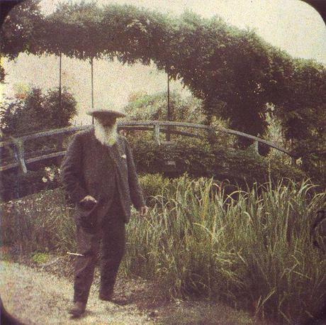 Claude Monet beside the Water Lily Pond bridge in 1917