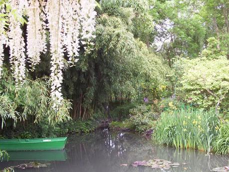 Claude Monet Water Lily Pond in Giverny - white wisteria hanging above boat - France