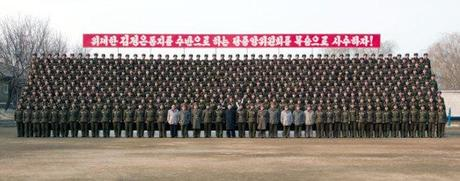 Kim Jong Un poses for a commemorative photograph with members of KPA Unit #323 (Photo: Rodong Sinmun)