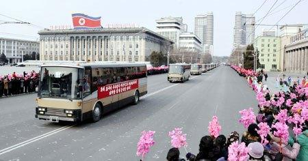 A motor coach ferrying personnel involved in the DPRK's third underground nuclear test passes through Kim Il Sung Square in central Pyongyang on 20 February 2013 (Photo: Rodong Sinmun)
