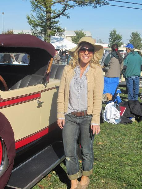 A Wide Brim Hat and a Antique Car on a Crisp Fall Day