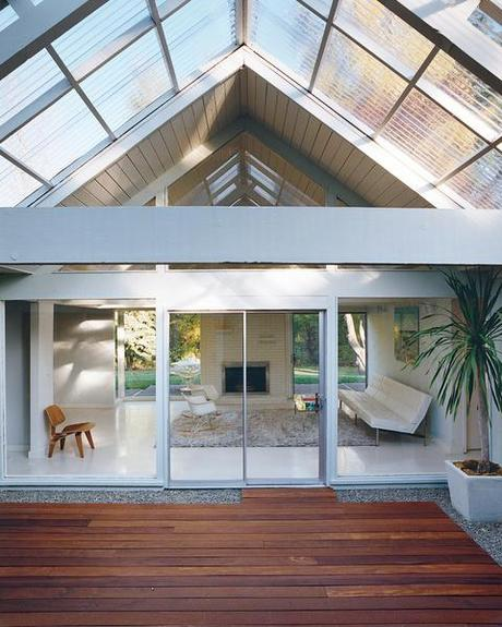 Modern deck with peaked ceiling and wooden flooring