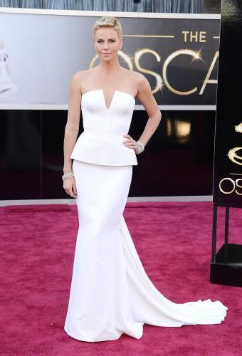 FAVE | WIN: Charlize Theron dazzled us in this white Dior Couture gown with a split neckline and peplum-trimmed bodice and over 100 carats of Harry Winston diamonds.