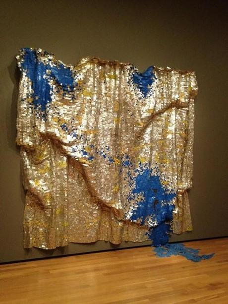 I don't have the time to write much today — yet — so in the meantime, I bring you a work by El Anatsui, whose gorgeous textiles are currently being shown at the Brooklyn Museum.