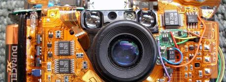 An Olympus Stylus camera without the case, showing the flex circuit assembly. (Credit: This image was originally posted to Flickr by jurvetson at http://flickr.com/photos/44124348109@N01/2265519)