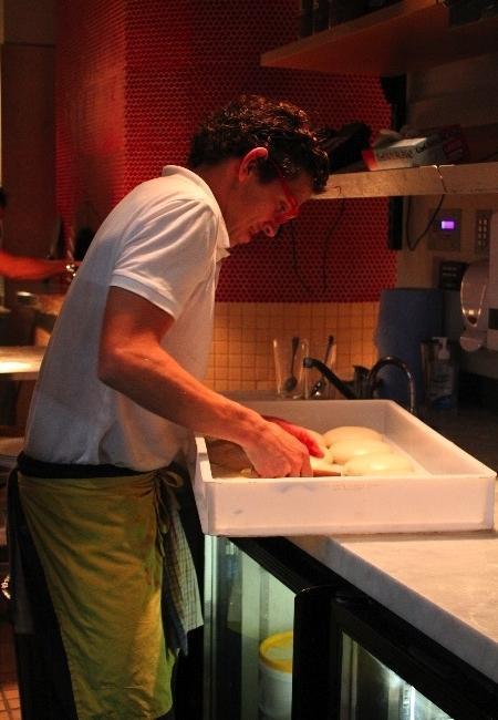 Stefano distributing the dough